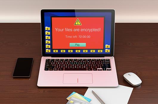 コンピューター画面上の赤いランサムウェアポップアップメッセージ